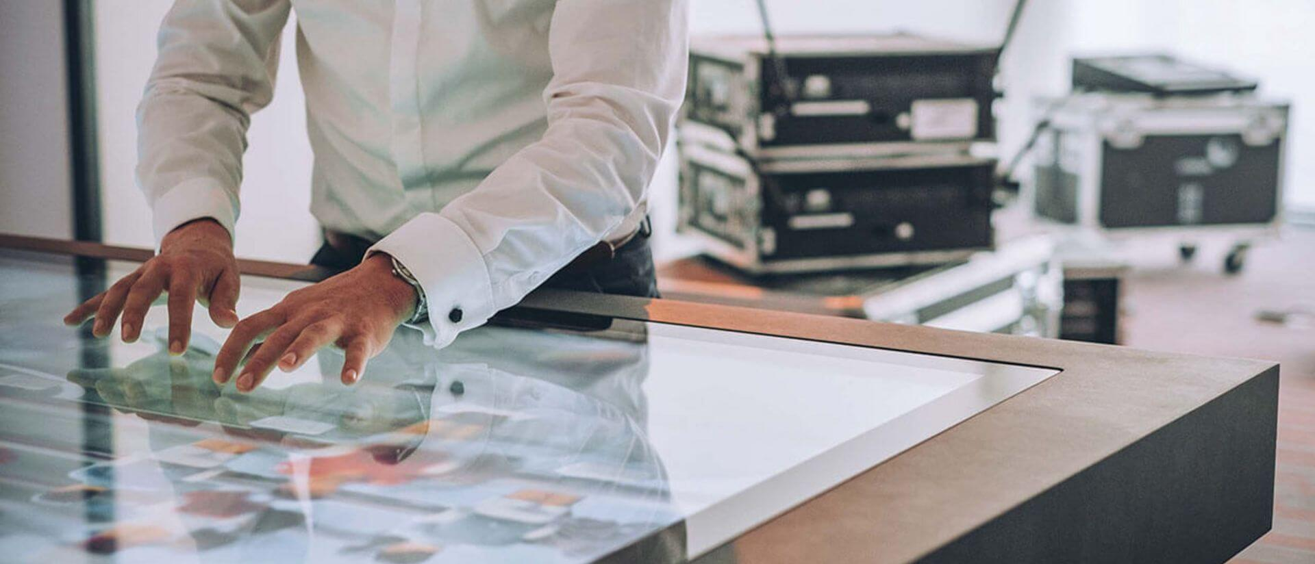digital event area with man working on a touch screen table