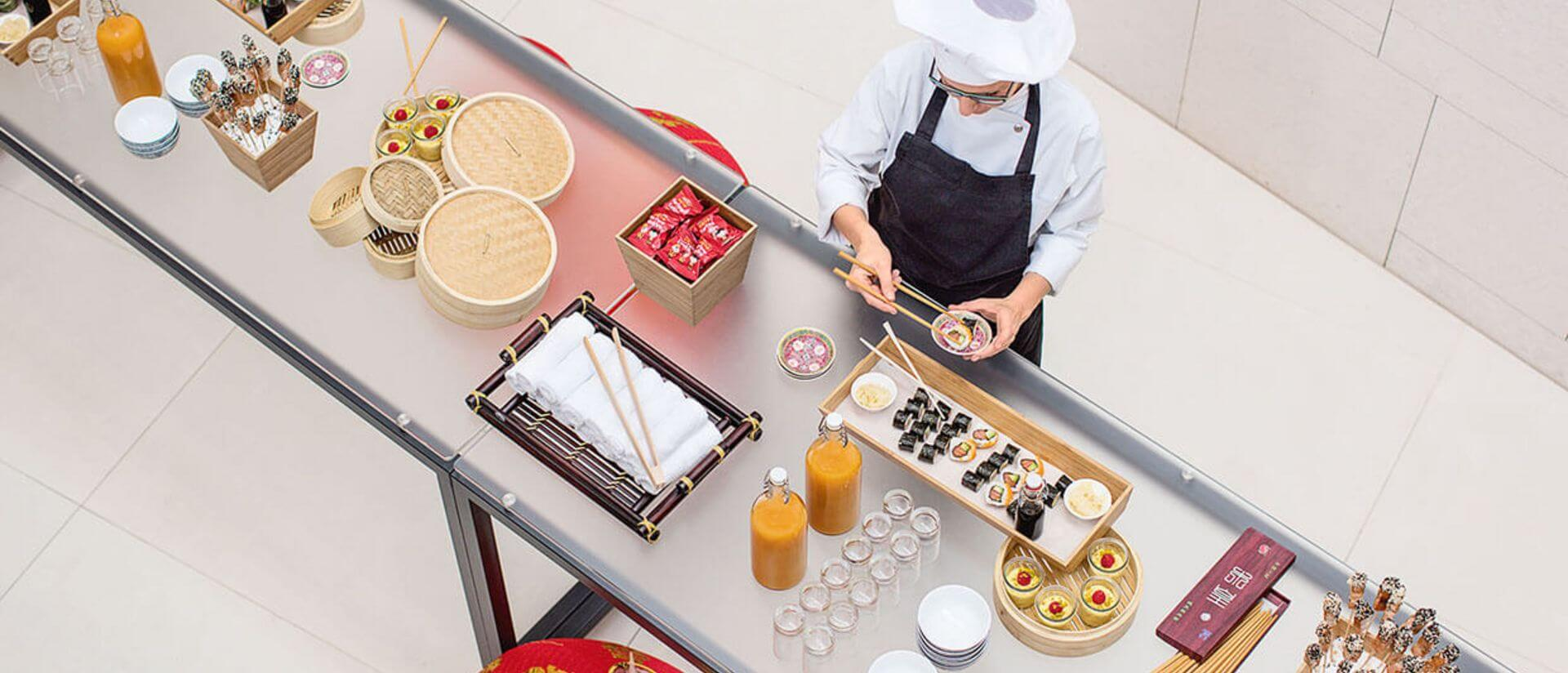 aerial view of cook setting food on a creative buffet
